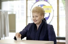 Lithuanian President and independent presidential candidate Dalia Grybauskaite casts her vote during the first round of the country's presidential election in Vilnius